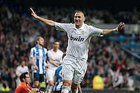24.03.2012 SPAIN -  La Liga matchday 30th  match played between Real Madrid CF vs Real Sociedad (5-1) at Santiago Bernabeu stadium. The picture show Karim Benzema (French Forward of Real Madrid) celebrating his team's goal