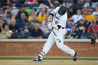 Gavin Sheets (24) of the Wake Forest Demon Deacons swings at the baseball during the game against the West Virginia Mountaineers in Game Four of the Winston-Salem Regional in the 2017 College World Series at David F. Couch Ballpark on June 3, 2017 in Winston-Salem, North Carolina.  The Demon Deacons walked-off the Mountaineers 4-3.  (Brian Westerholt/Four Seam Images)