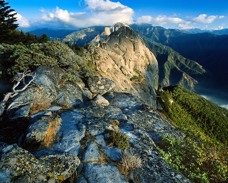 Moro Rock, dome-shaped granite monolith in Sequoia National Park, est. 9/25/1890. 404,051 acres (1,635 km2). Stairway to top first installed in 1917; now 797 ft, 400 steps lead to summit and spectacular views of western Sierra Nevada. Tulare County, CA.