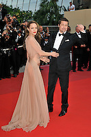 ANGELINA JOLIE &amp; BRAD PITT<br /> The &quot;Inglourious Basterds&quot; Premiere at the Grand Theatre Lumiere during the 62nd Annual Cannes Film Festival, Cannes, France.<br /> May 20th, 2009<br /> full length black tuxedo suit cream beige brown pink dress sheer long couple  back behind rear looking over shoulder arm in air waving hand <br /> CAP/PL<br /> &copy;Phil Loftus/Capital Pictures /MediaPunch ***NORTH AND SOUTH AMERICAS ONLY***