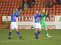 (left to right) Gavin Reilly, Alan Reid and Lee Robinson applaud the away fans at the end of the Aberdeen v Queen of the South William Hill Scottish Cup 5th Round match played at Pittodrie Stadium, Aberdeen on 4.2.12.