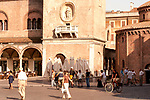 Piazza Erbe in Mantua, Italy at sunset with the Rotonda di S. Lorenzo and clock tower.