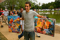 Visitors to Charlotte's Festival in the Park can purchase from a wide range of artwork.  For more than four decades, Charlotte's annual Festival in the Park has brought music, art and fun to Charlotteans and visitors. The festival has been chosen as one of Sunshine Artists Magazine's 200 Best Festivals.
