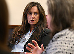 Bridgette Denison, center, listens as her sister-in-law Lauren Denison talks at the Legislative Building in Carson City, Nev., on Wednesday, March 13, 2013. The women are urging lawmakers to support a measure that would require suspects arrested for a felony to submit a DNA sample. The law is commonly referred to as Brianna's Law after Bridgette Denison's daughter Brianna who was murdered in Reno, Nev. in 2008. (AP Photo/Cathleen Allison)