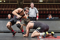 STANFORD, CA - January 18, 2015: Keaton Subjeck of the Stanford Cardinal wrestling team competes during a meet against Cal Poly at Maples Pavilion. Stanford won 22-13.