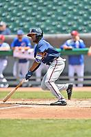 Mississippi Braves left fielder Travis Demeritte (18) swings at a pitch during a game against the Tennessee Smokies at Smokies Stadium on May 20, 2018 in Kodak, Tennessee. The Braves defeated the Smokies 7-4. (Tony Farlow/Four Seam Images)