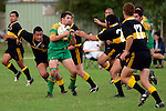 Drury left wing S. Fogrewici is surrounded by the Bombay defense.  Counties Manukau Premier Club Rugby, Drury vs Bombay played at the Drury Domain, on the 14th of April 2006. Bombay won 34 - 13.