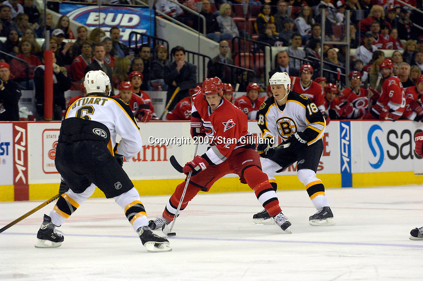 Carolina Hurricanes' Eric Staal (12) weaves between the Boston Bruins' Brad Stuart (6) and Mark Mowers (18) Saturday, Feb. 3, 2007 at the RBC Center in Raleigh. Boston won 4-3 in overtime.