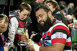 Simon Lemalu signs auotgraphs for fans after the game. ITM Cup rugby game between Counties Manukau and Manawatu played at Bayer Growers Stadium on Saturday August 21st 2010..Counties Manukau won 35 - 14 after leading 14 - 7 at halftime.
