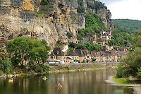 The village of La-Roque-Gigeac in Perigord, which seems to be pressed down into the River Dordogne by the towering cliffs looming over it, is officially one of France's hundred most beautiful villages.