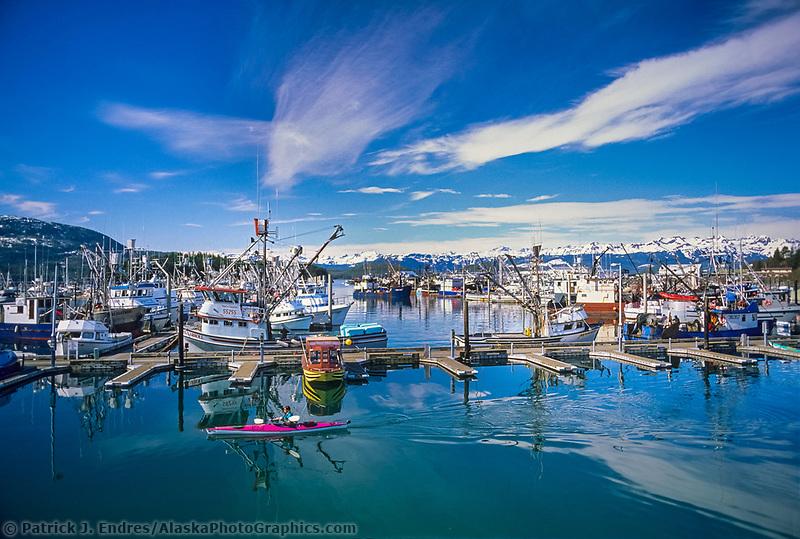 Sea kayaker, Cordova boat harbor, Prince William Sound, Alaska.