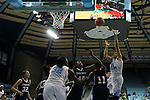 11 November 2012: North Carolina's Krista Gross (21) shoots over Duquesne's April Robinson (32), Stasia King (42), Ahjah Hall (11), and North Carolina's Waltiea Rolle (32). The University of North Carolina Tar Heels played the Duquesne University Dukes at Carmichael Arena in Chapel Hill, North Carolina in an NCAA Division I Women's Basketball game, and a quarterfinal in the Preseason WNIT. UNC won the game 62-58
