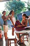 FRENCH POLYNESIA, Tahiti. A family of sisters a their home in Papenoo.