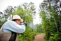 Bob Standish fires at a sporting clay at Side by Side in Sanford, NC.