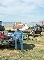 Hay farmer in Cowdrey, Colorado, Sunday, August 23, 2015.<br /> <br /> Photo by Matt Nager