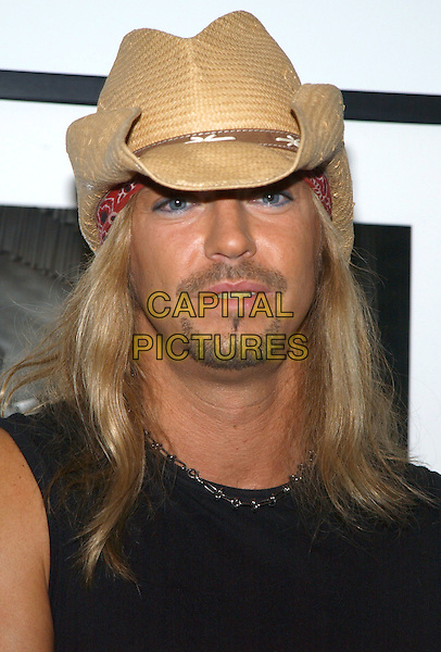 "BRET MICHAELS.Singer Bret Michaels is in critical condition suffering from a brain hemorrhage, his publicist Joann Mignano said. Michaels the former Poison frontman was rushed to intensive care late Thursday after a severe headache. Doctors discovered bleeding at the base of his brain stem. The 47-year-old glam-rock reality TV star had an emergency appendectomy at a private care facility for diabetics last week after complaining of stomach pains before he was scheduled to perform in San Antonio, Texas. Michaels is currently a contestant on the third season of Donald Trump's NBC competitive reality show, ""The Celebrity Apprentice."" Trump said in a statement Friday that he was ""deeply saddened"" to hear of Michaels' condition - USA - 23rd April 2010..FILE PHOTO: Singer BRET MICHAELS of Poison donates  the guitar he wrote 'Every Rose Has It's Thorn' to museum curator Jim Henke at the Rock and Roll Hall of Fame and Museum, Cleveland, OH, USA, May 31st, 2003..portrait headshot  black cowboy hat facial hair goatee beard sleeveless top  .CAP/ADM/LF.©Laura Farr/AdMedia/Capital Pictures."