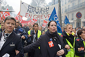 French employees of British Airways join a mass demonstration in Paris against a new work contract, introduced by Prime Minister Dominique de Villepin, that allows companies with fewer than 20 employees to fire them within two years instead of six months.