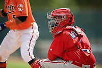 Philadelphia Phillies catcher Juan Aparicio (4) looks into the dugout during a Florida Instructional League game against the Baltimore Orioles on October 4, 2018 at Ed Smith Stadium in Sarasota, Florida.  (Mike Janes/Four Seam Images)