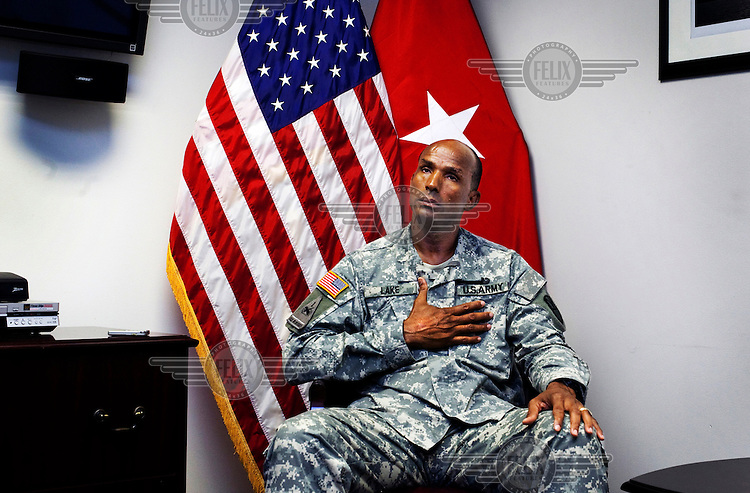 JFT (Joint Fires Team) Deputy Commander Lake in his office at the American naval base at Guantanamo Bay, where over 600 alleged al Qaeda members have been held indefinitely. Described by the US as 'unlawful enemy combatants', they were captured primarily in Afghanistan during the 'war against terror'.