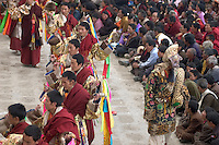 Monks dance with ribbons representing deity powers at the Monlam Chenmo, Katok Monastery - Kham, (Tibet), Sichuan, China