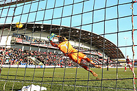 Lee Nicholls of MK Dons can't prevent the equalising goal from Ashley Hunter of Fleetwood Town (not pictured) during the Sky Bet League 1 match between Fleetwood Town and MK Dons at Highbury Stadium, Fleetwood, England on 24 February 2018. Photo by David Horn / PRiME Media Images