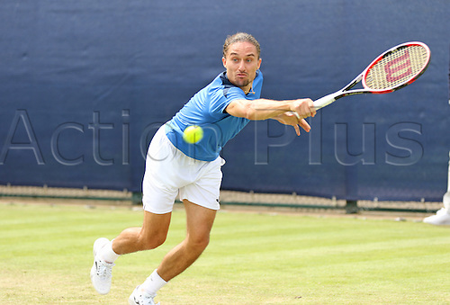 21.06.2016. Nottingham Tennis Centre, Nottingham, England. Aegon Open Mens ATP Tennis. Alexandr Dolgopolov of Ukraine reaches for a backhand as he defeats Kyle Edmund of Great Britain 6-4 7-6