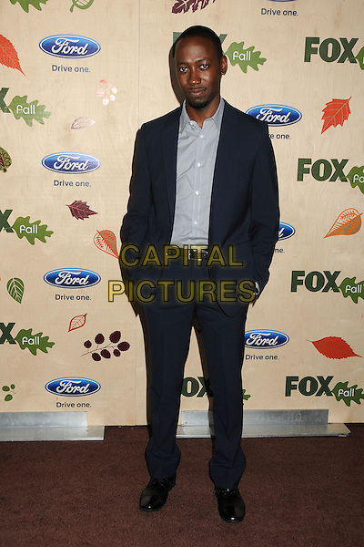 Lamorne Morris.7th Annual Fox Fall Eco-Casino Party held at The Bookbindery, Culver City, California, USA..September 12th, 2011.full length suit shirt hands in pcckets black grey gray.CAP/ADM/BP.©Byron Purvis/AdMedia/Capital Pictures.