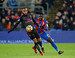 Crystal Palace's Jeffrey Schlupp tussles with Arsenal's Alexandre Lacazette during the premier league match at Selhurst Park Stadium, London. Picture date 28th December 2017. Picture credit should read: David Klein/Sportimage