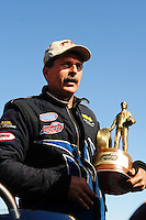 Sept. 6, 2010; Clermont, IN, USA; NHRA top alcohol dragster driver Marty Thacker celebrates after winning the U.S. Nationals at O'Reilly Raceway Park at Indianapolis. Mandatory Credit: Mark J. Rebilas-