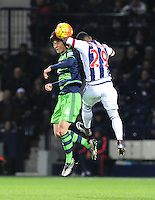 Ki Sung-Yueng of Swansea City and Stephane Sessegnon of West Bromwich Albion during the Barclays Premier League match between West Bromwich Albion and Swansea City at The Hawthorns on the 2nd of February 2016