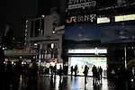 March 22, 2011, Tokyo, Japan - TokyoÅfs Shibuya, once brightly-lit fun town, now is gone as stores and shops dim down lights and turn off neon signs on Tuesday, March 22, 2011. PeopleÅfs lives have been disrupted in the greater Tokyo area as Tokyo Electric Power Co. began its first-ever rolling blackout to help prevent an unexpected large-scale power outage after a powerful earthquake shut two nuclear plants indefinitely on March 11. (Photo by AFLO) [3620] -mis-