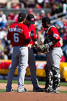 Justin Miller (25) of the Frisco RoughRiders talks with Guilder Rodriguez (6) and Robinzon Diaz (23) during a game against the Springfield Cardinals on April 16, 2011 at Hammons Field in Springfield, Missouri.  Photo By David Welker/Four Seam Images.