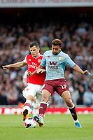 Granit Xhaka of Arsenal and Mahmoud Hassan Trezeguet of Aston Villa during the Premier League match between Arsenal and Aston Villa at the Emirates Stadium, London, England on 22 September 2019. Photo by Carlton Myrie / PRiME Media Images.