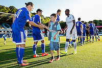 Players line up with mascots ahead of the Friendly match between Wycombe Wanderers and Brentford at Adams Park, High Wycombe, England on 19 July 2016. Photo by David Horn / PRiME Media Images.