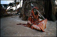 El Wak, NE Kenya, March 2006.Makai Mahad, said to be 100, is a 'drop-out', one of million semi-nomadic herdsmen who are leaving the bush to come and live in camps near villages as their livestock is decimated by a persistent drought, abandonning their traditional lifestyle.