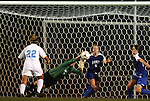 24 September 2009: Duke's Tara Campbell (1) makes a diving save between Duke's Jane Alukonis (5) and North Carolina's Amber Brooks (22). The University of North Carolina Tar Heels defeated the Duke University Blue Devils 2-1 in sudden victory overtime at Fetzer Field in Chapel Hill, North Carolina in an NCAA Division I Women's college soccer game.