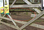 Pictured:  REVEAL:  The gap (circled) in the gate - SEE THE MAIN IMAGE.<br /> <br /> This mind-blowing optical illusion of a dog jumping through the wooden panels of a gate is bound to cause double-takes.  Cocker spaniel Bailey appears to defy physics by warping through the gate while out on a walk with its owners.<br /> <br /> However, the confusing image was simply a perfectly-timed shot of the animal leaping through what is a cocker spaniel-sized hole in the gate.  Photographs of the gate in Hampshire's pretty New Forest reveal the hole in its centre panel.  SEE OUR COPY FOR DETAILS.<br /> <br /> Please byline: Zack Maynard/Solent News<br /> <br /> © Zack Maynard/Solent News & Photo Agency<br /> UK +44 (0) 2380 458800