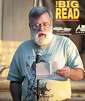 "Thomas Burkdall, Associate Professor, Writing & Rhetoric<br /> People gather to listen to poetry outside the Mary Norton Clapp Library during the Kick-Off event for ""The Big Read: Robinson Jeffers and the Ecologies of Poetry"" at Occidental College on October 1, 2009. A Robinson Jeffers exhibit was also unveiled and a bobcat from the Wildlife Waystation was also at the event. Jeffers was a graduate of the class of 1905.<br /> (Photo by Marc Campos, College Photographer)"