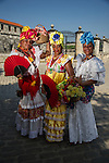 HAVANA, CUBA - DECEMBER 30: A Cuban women in traditional clothing in Havana on December 30, 2013. With the growth of foreign tourism, man Cuban peopler are make their living posing as traditional cuban characters.