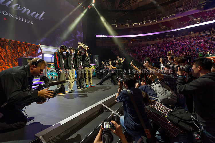 7/21/2014&mdash;Seattle, WA, USA<br /> <br /> Here:  Zhang &lsquo;xiao8&rsquo; Ning of the DOTA 2 team Newbee holds up the trophy, modeled on a virtual shield from Dota 2 called the Aegis of Champions.  Newbee were the winners of The International, an annual tournament for the online arena battle game Dota 2.<br /> <br /> Newbee won the best of five final, 3 games to 1.<br /> <br /> &quot;The International&quot; is a video-game tournament hosted by Valve, a game maker based in Bellevue, WASH., with a prize pool reaching $10.8 million. this year the event was held at Key Arena in Seattle, WASH.<br /> <br /> Contestants were playing Dota 2, a 2013 multiplayer online battle arena video game developed by Valve. Five players are on each team, with teams traveling for around the world to battle at the sold-out event.<br /> <br /> <br /> Photograph by Stuart Isett<br /> &copy;2014 Stuart Isett. All rights reserved.
