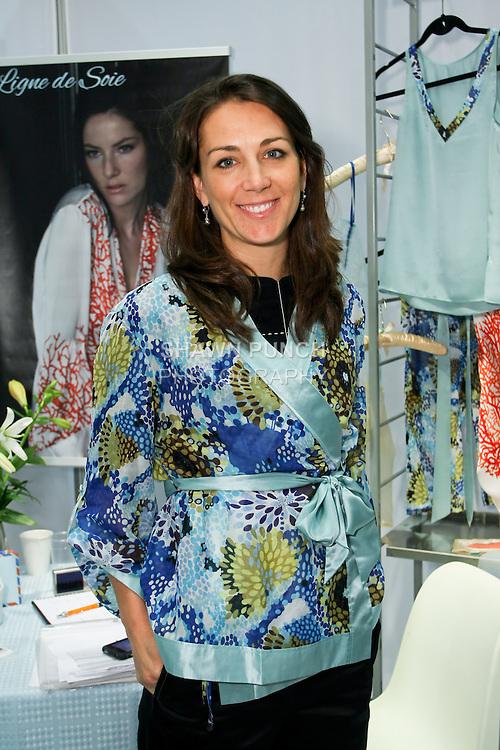 Melissa Pelz wears a Ligne de Soie top during the CURVENY Designer Lingerie & Swim show, at the Jacob Javits Convention Center, August 3, 2010.