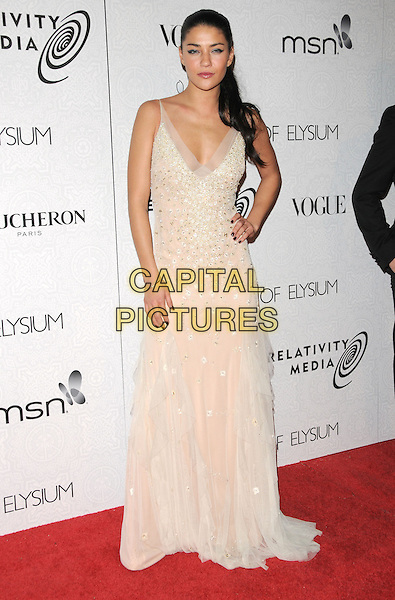 "JESSICA SZOHR .at Art of Elysium 3rd Annual Black Tie charity gala '""Heaven"" held at 990 Wilshire Blvd in Beverly Hills, California, USA, January 16th 2010 .                                                                  arrivals full length beige cream long maxi dress hand on hip beaded sleeveless silk chiffon .CAP/RKE/DVS.©DVS/RockinExposures/Capital Pictures"