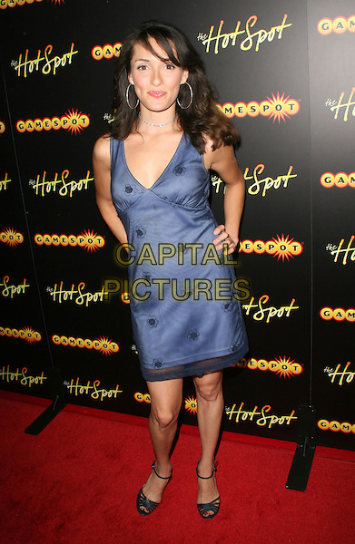 MARLEY TAYLOR .GameSpot presents GameSpot HotSpot in celebration of the nation's largest Video Gaming Conference at Goa Nightclub, Hollywood, California, USA, 15 July 2008..full length blue dress hands on hips .CAP/ADM/FS.©Faye Sadou/Admedia/Capital Pictures