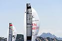 """Louis Vuitton Trophy La Maddalena 4 giugno 2010. Gli spinnaker di Emirates Team New Zealand e Artemis durante una delle regate della semifinale. Sullo sfondo i """"monti"""" della Gallura"""