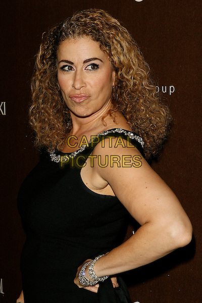 ROMA MAFFIA.The 10th Annual Costume Designers Guild Awards held at the Beverly Wilshire Hotel, Beverly Hills, California, USA..February 19th, 2008.half length black dress hand on hip diamond bracelets trim funny face .CAP/ADM/ZL.© Zach Lipp/AdMedia/Capital Pictures.