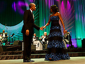 United States President Barack Obama and first lady Michelle Obama on stage following the President's remarks at the Congressional Black Caucus Foundation's 45th Annual Phoenix Awards Gala at the Walter E. Washington Convention Center, September 19, 2015 in Washington, DC. <br /> Credit: Aude Guerrucci / Pool via CNP