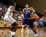 SIOUX FALLS, SD - NOVEMBER 26:  Andre Wallace #20 from South Dakota State University tries to get a step past A.J. Merriweather #13 from East Tennessee State University during their game at the Sanford Pentagon Saturday evening in Sioux Falls. (Photo by Dave Eggen/Inertia)