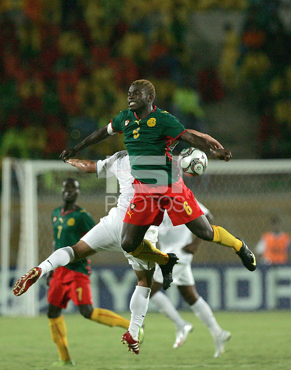 Cameroon's Charley Fomen (6) collides with USA's Danny Cruz (5) during the FIFA Under 20 World Cup Group C Match between the United States and Cameroon at the Mubarak Stadium on September 29, 2009 in Suez, Egypt.
