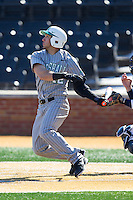 Eric Escobedo (12) of the Marshall Thundering Herd follows through on his swing against the Georgetown Hoyas at Wake Forest Baseball Park on February 15, 2014 in Winston-Salem, North Carolina.  The Thundering Herd defeated the Hoyas 5-1.  (Brian Westerholt/Four Seam Images)