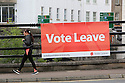 A woman walks past a 'Vote Leave' poster fixed to a bridge in Enniskillen, County Fermanagh, Thursday, June 23rd, 2016, as voting got under way for the EU referendum on wether the United Kingdom should remain a member of the European Union or Leave the European Union.
